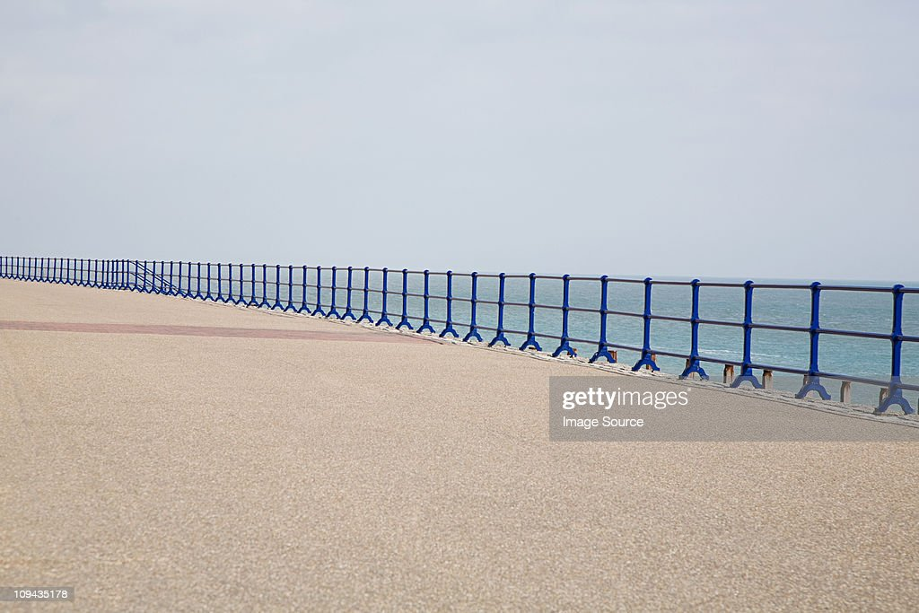 Blue railings and promenade : Stock Photo
