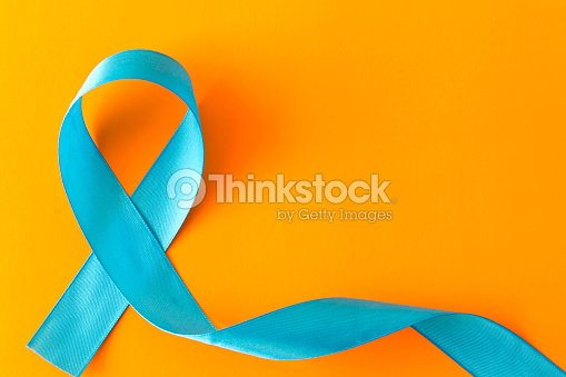 Blue ribbon.  Isolated on orange background with empty space for text : Foto de stock