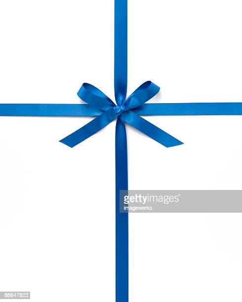 Blue ribbon with bow against white background, close-up