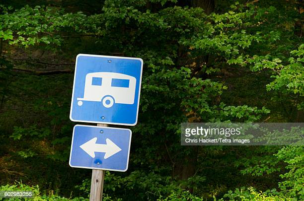 USA, Blue road sign with forest in background