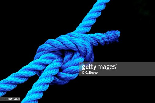 Blue rope knot on black background