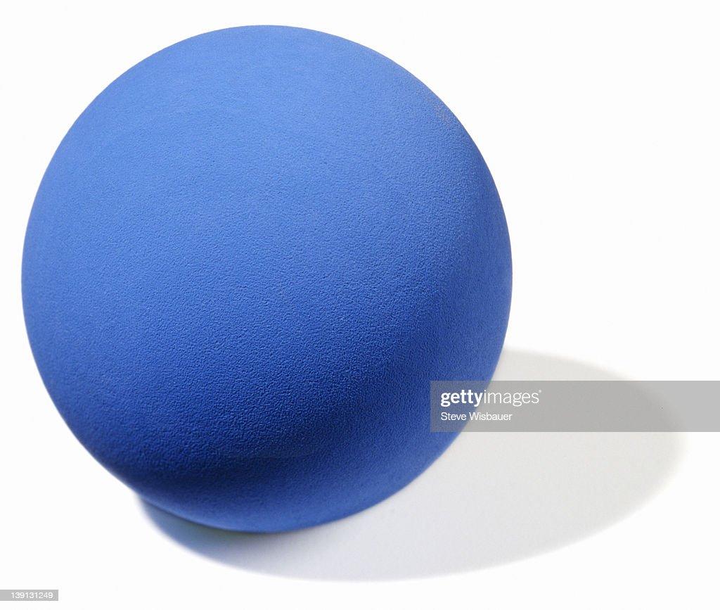 A blue rubber ball for racquetball or handball