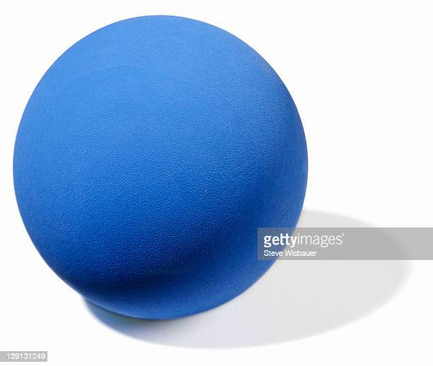 A blue rubber ball for racquetball or handball