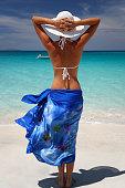 woman wearing blue sarong on a tropical Caribbean beach