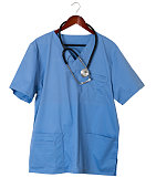 Blue medical scrubs uniform shirt hanging on a hook on back of door with stethoscope with copy space for message