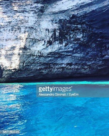 Blue Sea Against Rock Formation