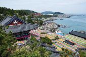 Blue sea, colorful lanterns and Buddhist temple