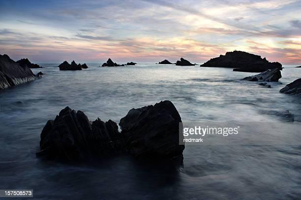 Blue sea during sunset in Devon England