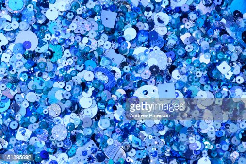 Blue sequins of various shapes and sizes