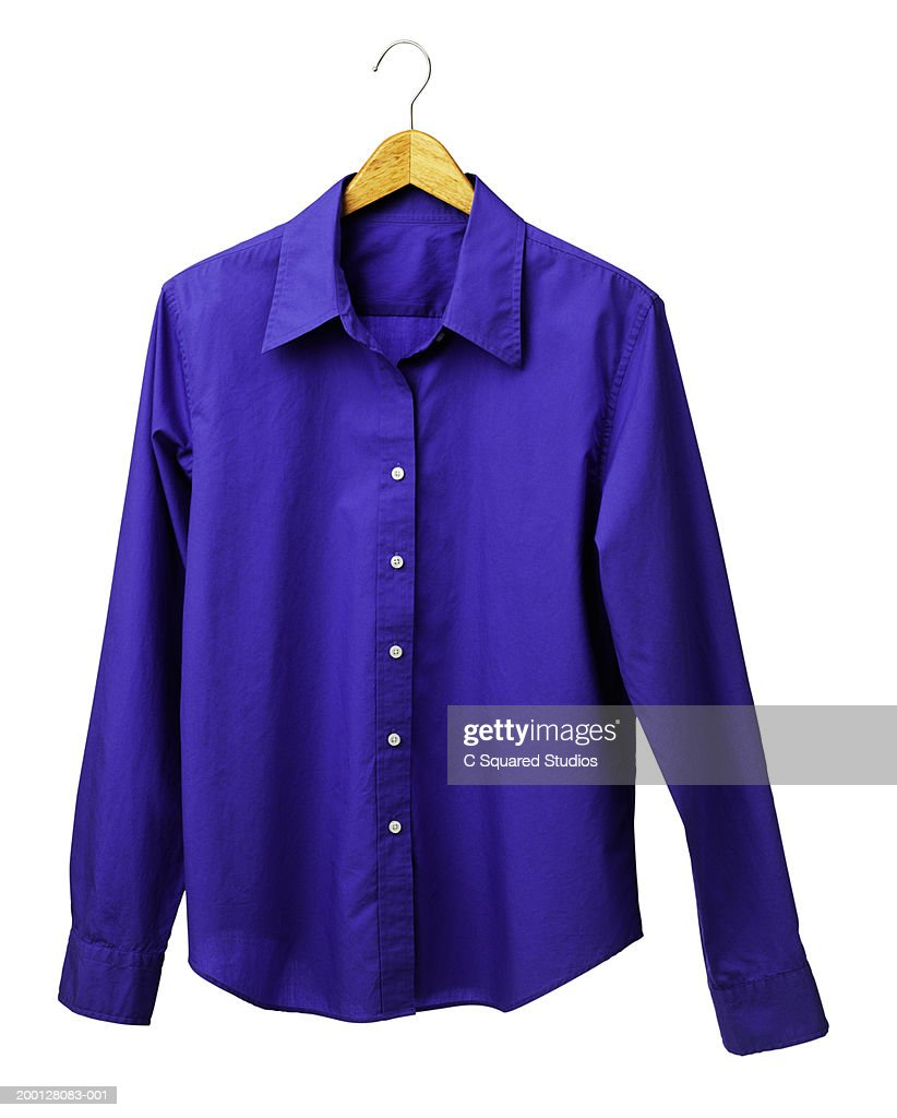 Blue shirt on wooden clothes hanger