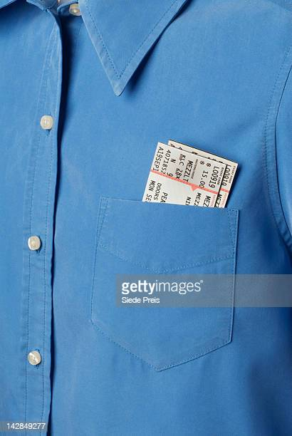 Blue shirt with tickets in pocket