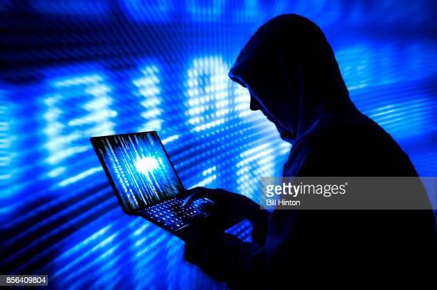 Blue silhouette hacker