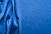 Blue silk fabric background. Abstract wavy texture