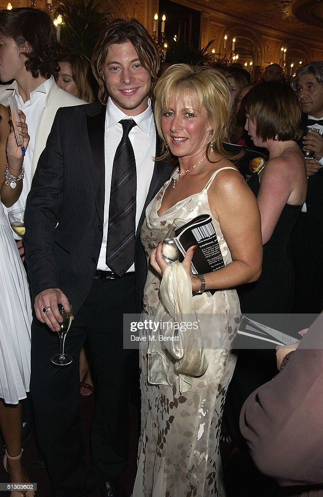 Blue singer Duncan James and his mother attend the Royal Gala Premiere of Lord Andrew Lloyd Webber's new musical 'The Woman In White' at the Palace Theatre, Shaftesbury Avenue on September 13, 2004 in London.