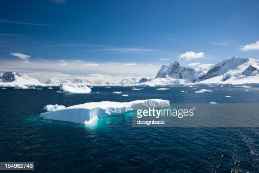 Blue sky above sea with icebergs