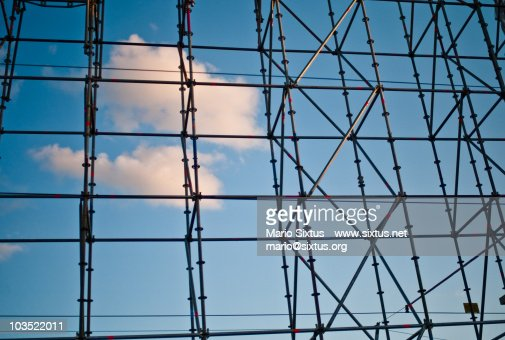 Blue sky and clouds behind scaffold