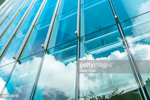 blue sky and clouds reflected at glass wall : Stock Photo