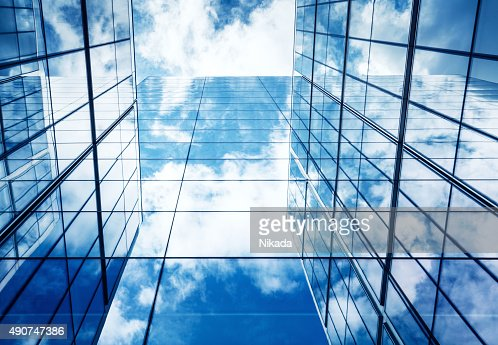 Blue Sky and Clouds Reflected in Modern Glass Architecture