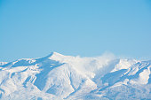 Blue sky and summit of winter mountain Mt. Tokachi Hokkaido Japan