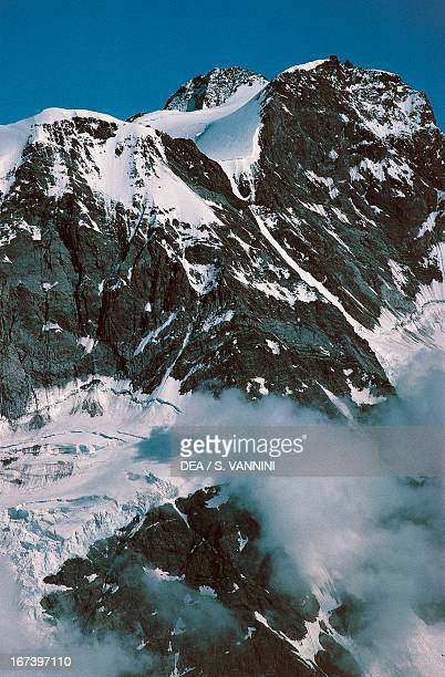 Blue sky and white clouds on the Italian side of Monte Rosa Pennine Alps Valle d'Aosta region Italy