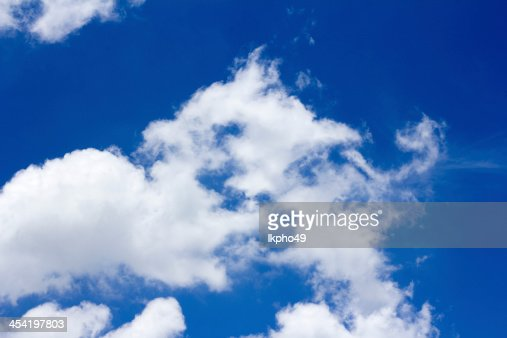 blue sky background with tiny clouds : Stock Photo
