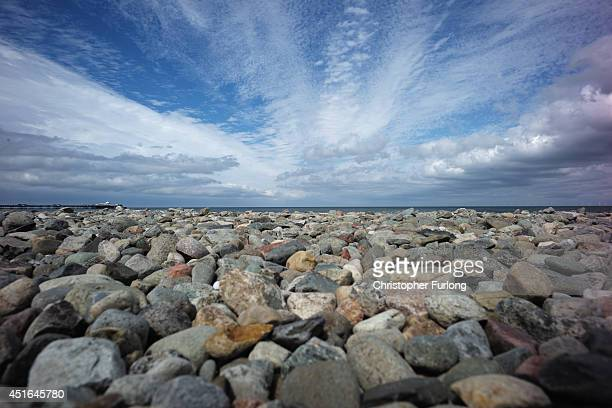 A blue sky breaks through the clouds over Llandudno's famous pebble beach on July 3 2014 in Llandudno Wales Llandudno is known as the 'Queen of the...