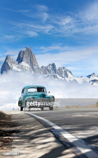 Blue sky over antique car driving in Patagonia Argentina