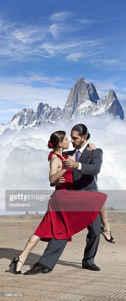 Blue sky over argentine couple dancing tango in Patagonia : Stock Photo