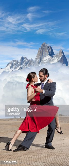 Blue sky over argentine couple dancing tango in Patagonia