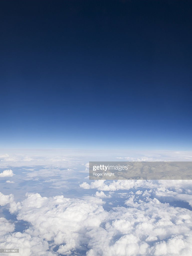 Blue sky over clouds, aerial view : Stock Photo