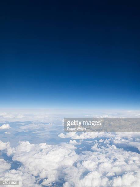 Blue sky over clouds, aerial view
