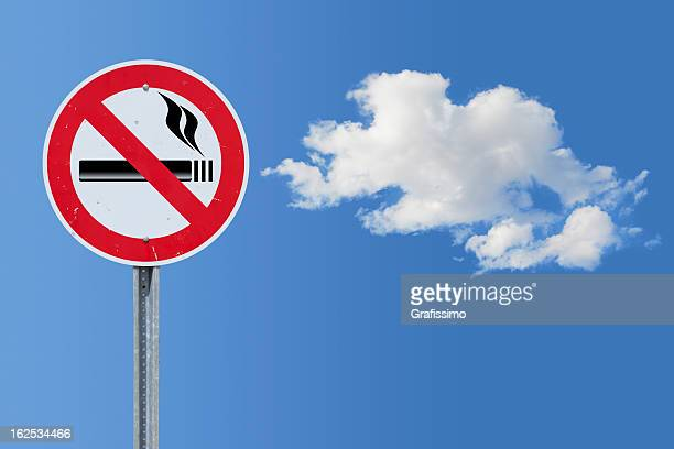 Blue sky over no smoking traffic sign