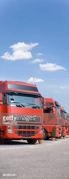 Blue sky over red trucks