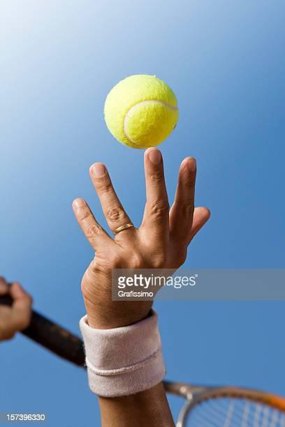 Blue sky over tennis player