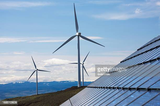 Blue sky over wind farm and solar panels with copy space