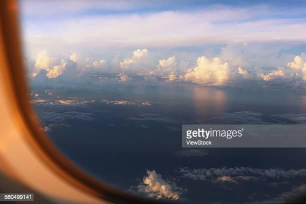 Blue sky viewed through airplane window