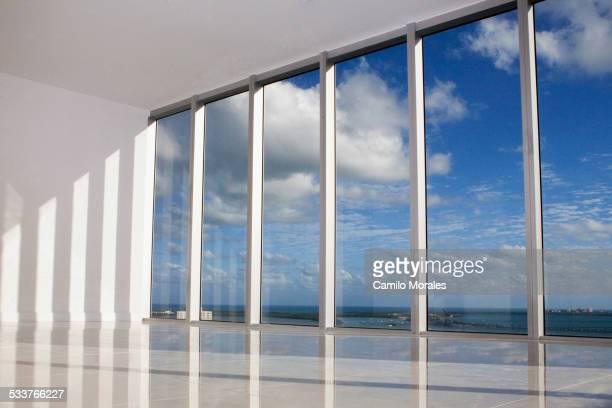 Blue sky viewed through windows in modern apartment