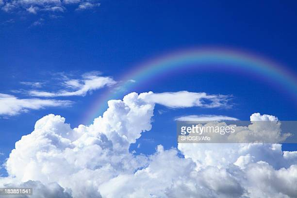Blue sky with clouds and rainbow