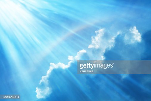 Blue Sky With Rainbow and Sun Reflection