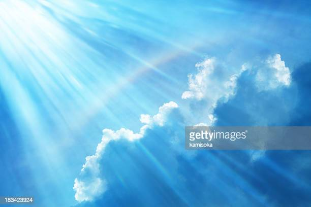Blue Sky With Rainbow and Sun Reflection