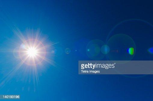 Blue sky with solar flare