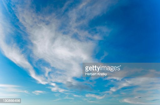 Blue sky with thin clouds