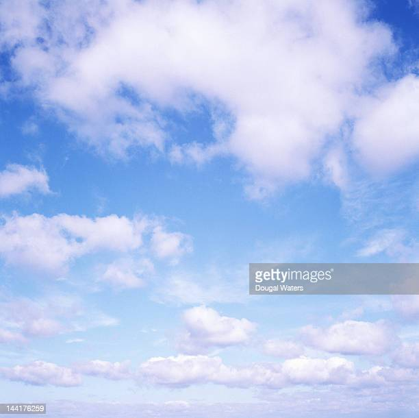 Blue sky with white fluffy clouds.
