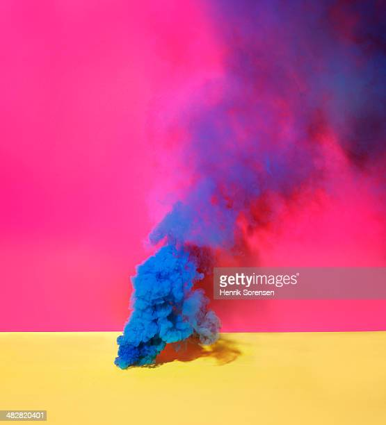 Blue smoke on red and yellow background