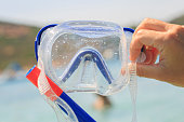 Blue Snorkel glasses in the hand