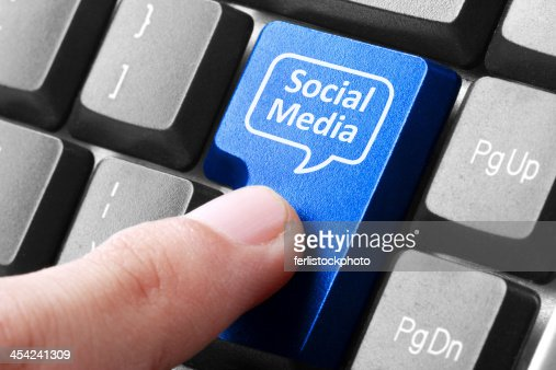 Blue social media button on the keyboard : Stock Photo