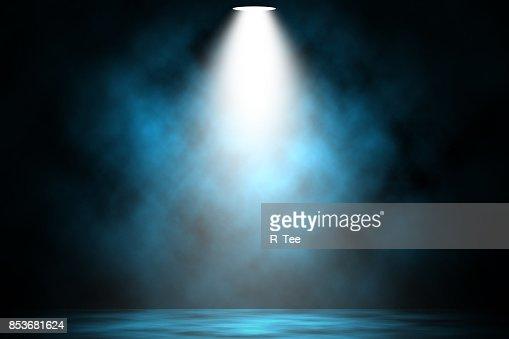 Blue spotlight smoke stage entertainment background. : Stock Photo