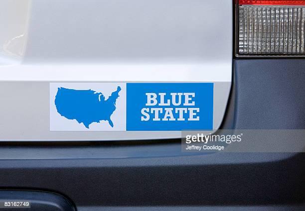 Blue state bumper sticker on car