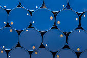 blue steel chemical tanks or oil tanks stacked in a row. background and texture