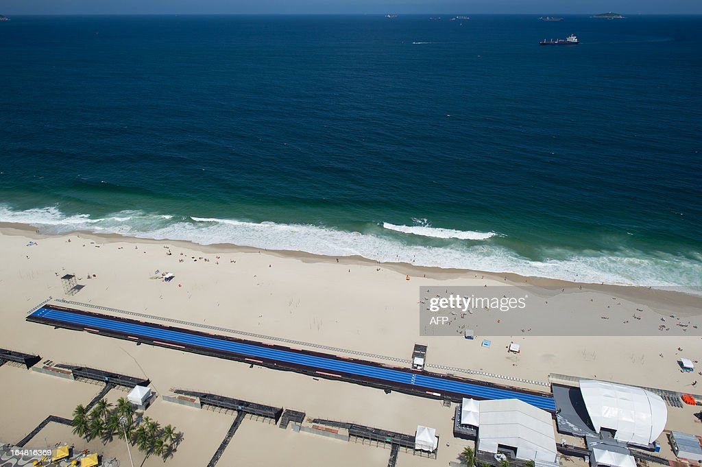 Blue straight lanes are installed on Copacabana Beach in Rio de Janerio, Brazil, on March 28, 2013. World's fastest runner Jamaican Usain Bolt and other international athletes will compete in a temporarily set 150m straight arena in the event 'Mano a Mano' (Hand to Hand) at Copacabana beach on March 31. AFP PHOTO/Yasuyoshi CHIBA